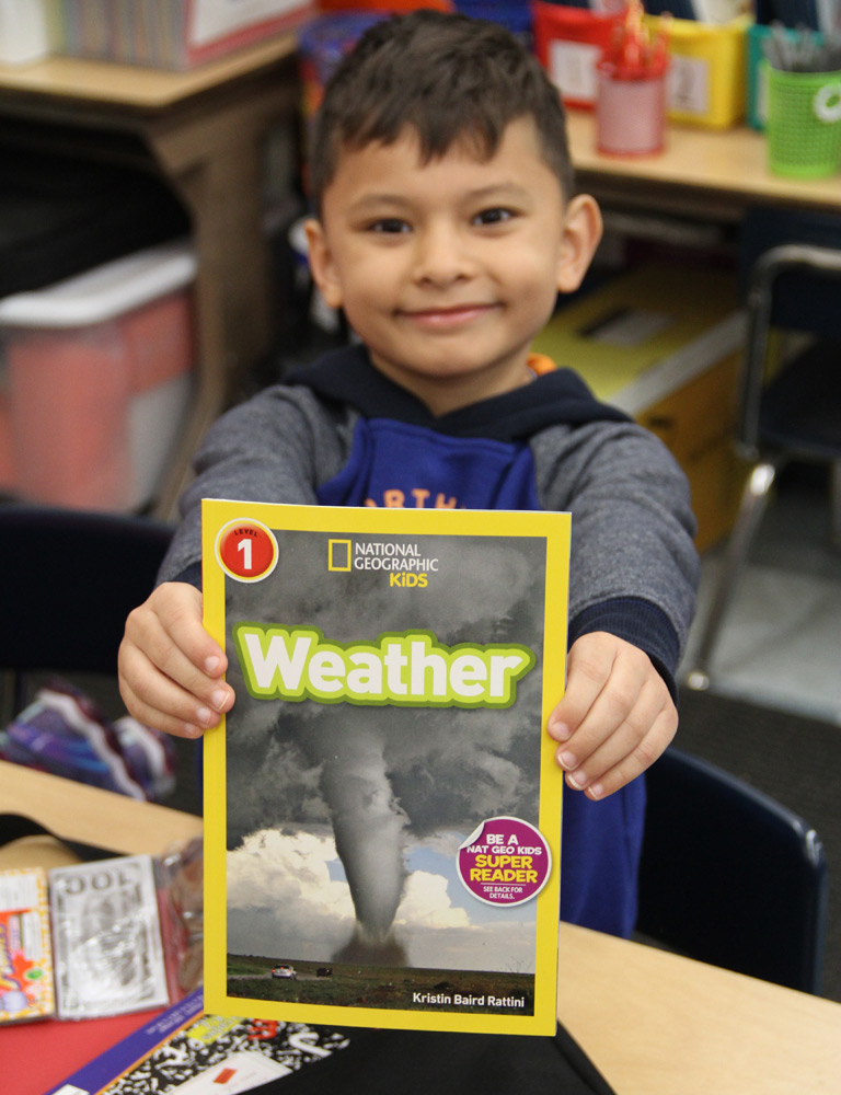 Operation Teddy Bear student with STEM book